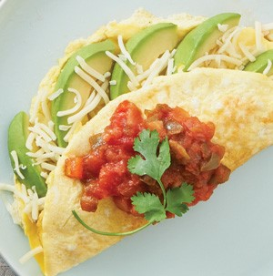 Avocado omelet topped with salsa and cilantro