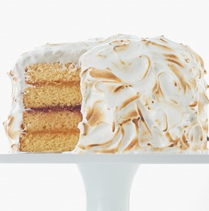 Four layer cake with jam in the middle and toasted meringue on the outside
