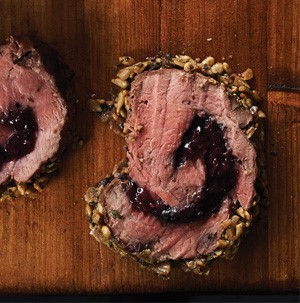 Beef tenderloin swirled with berry sauce and encrusted with sunflower kernels