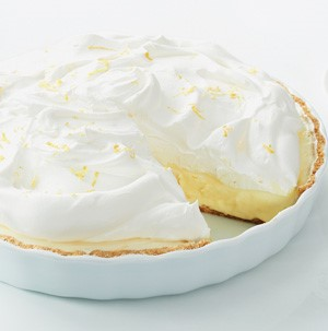 Pie plate filled with ice cream and topped with whipped cream and lemon zest