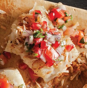 Cod topped with pomegranate seeds, diced peppers, red onion, and toasted coconut