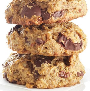 3 cookies stacked on top of each other with large chunks of chocolate