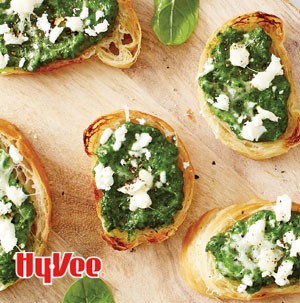 Thinly sliced mini croissants topped with spinach, feta cheese, pine nuts and parmesan