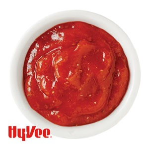 Spicy ketchup in a small white bowl