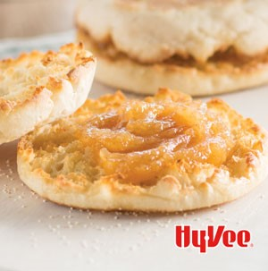 Apple butter spread on open faced English muffins