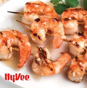 Plate of citrus-marinated shrimp skewers