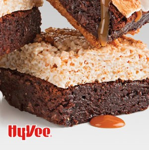Fudgy brownies topped with rice crispy treas and drizzled in caramel sauce