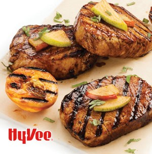 Plate of grilled pork chops garnished with pear slices