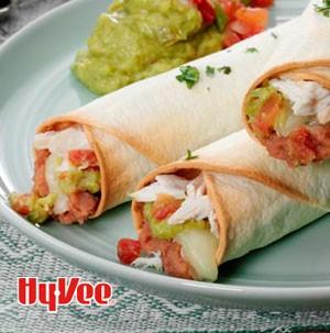 Plate of chicken guacamole taquitos