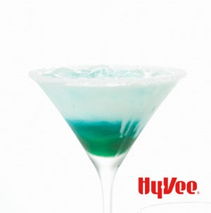 Blue and white drink in martini glass