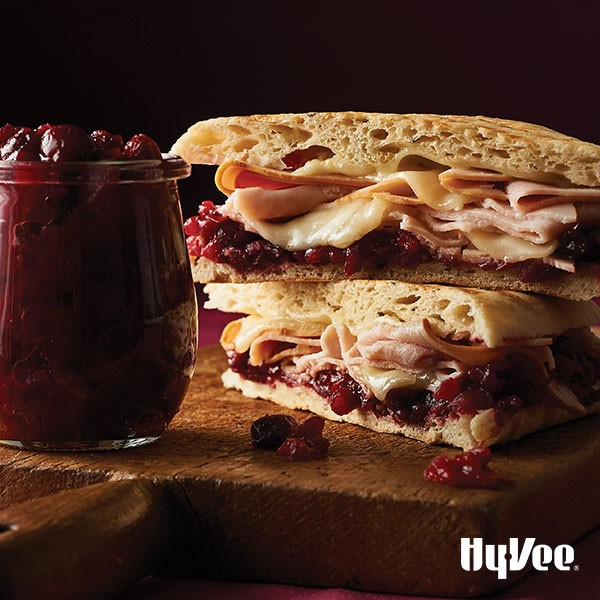 Artisan bread topped with cranberry sauce, cheese, and sliced turkey
