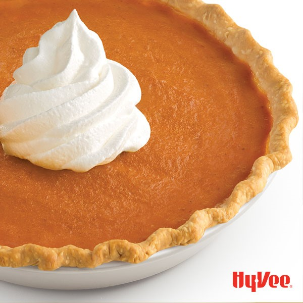 Sweet potato pumpkin pie served with a dollop of whipped topping