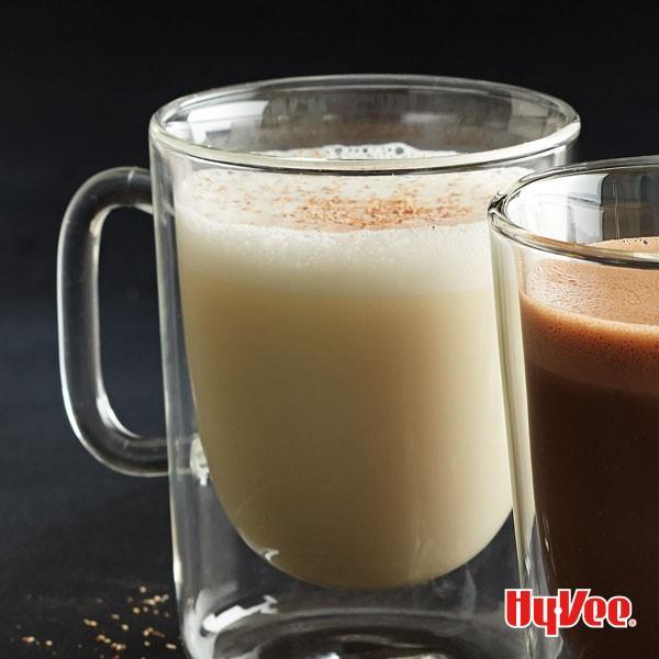 Hot white chocolate in glass mug