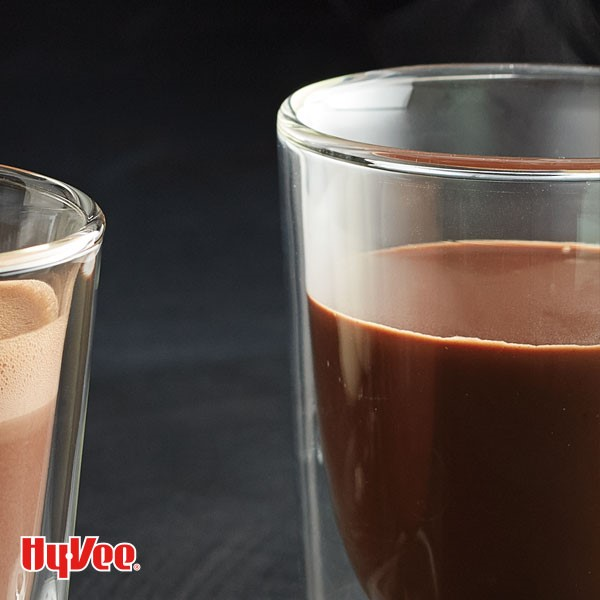 Glass filled with dark hot chocolate