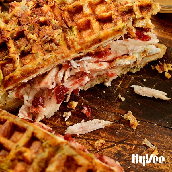 Cranberry turkey waffle sandwich on a wooden board