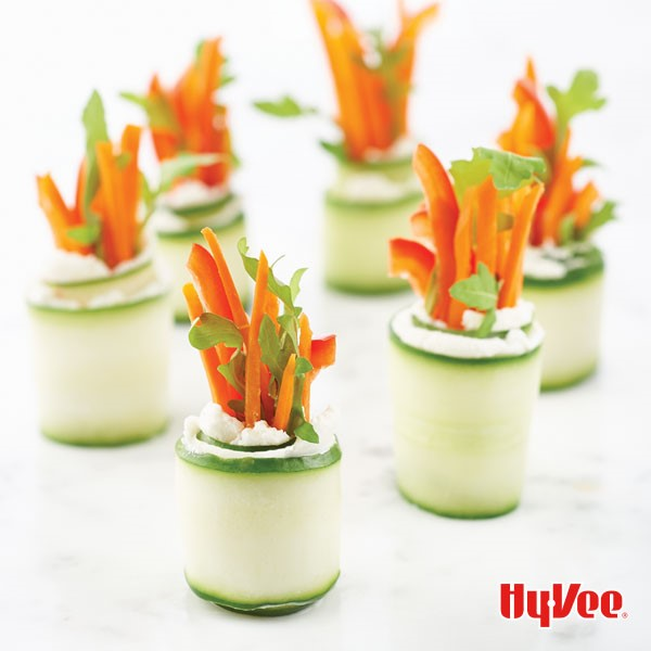 Cucumber roll ups filled with goat cheese, carrots, red bell pepper and fresh parsley