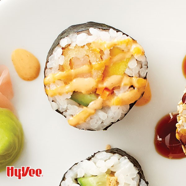 Crispy shrimp roll drizzled with dynamite sauce