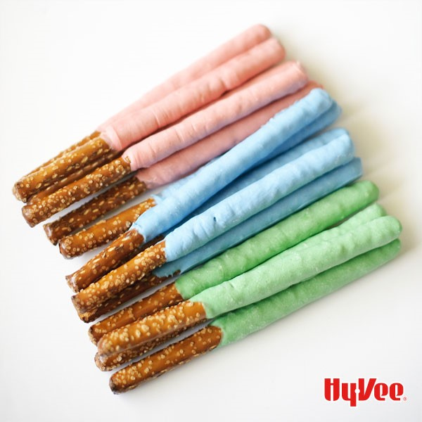 Pretzel sticks dipped in pink, blue, and green chocoalte
