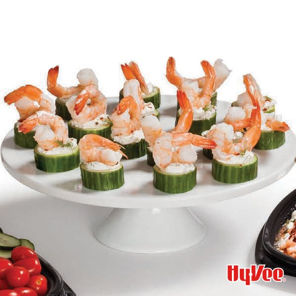Cake platter of chilled shrimp and cucumber