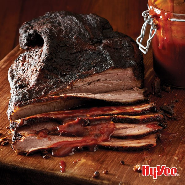 Chef Mark's KC smoked brisket partially sliced on a wooden board