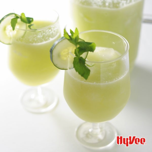 Glasses of cucumber mint lemonade, garnished with cucumber slices and fresh mint leaves