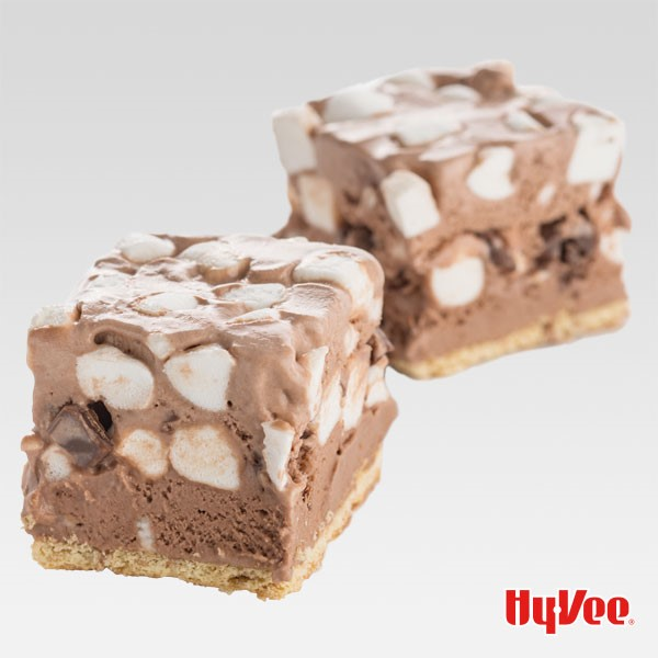 Two campfire s'more treat squares mixed with mini marshmallows