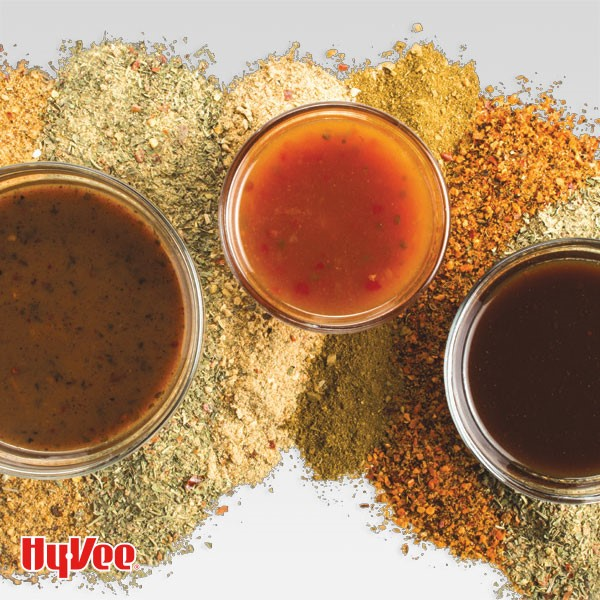 3 dipping sauces atop various ground spices