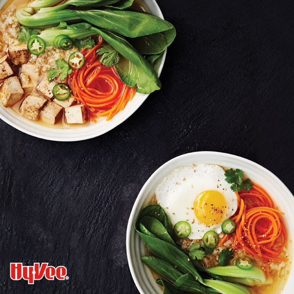 Bowl of Buddha broth topped with a fried egg and marinated tofu