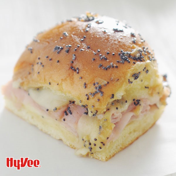 Hy-Waiian bun topped with poppy seeds and filled with ham and cheese