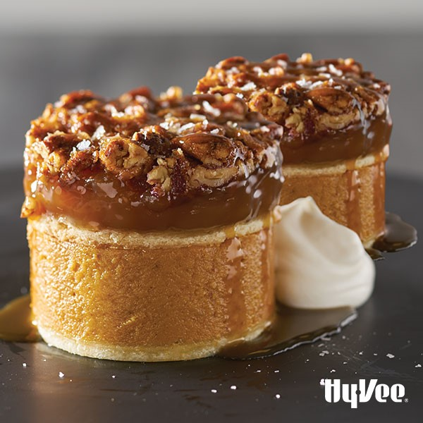 Rounds of pumpkin pie topped with rounds of pecan pie