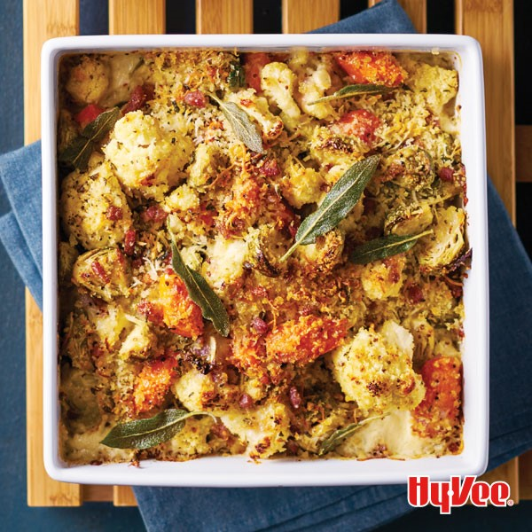 Tomatoes, cauliflower and sage leaves in a square casserole dish