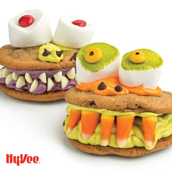 sandwich cookie with candy corn teeth and large marshmallow eyes
