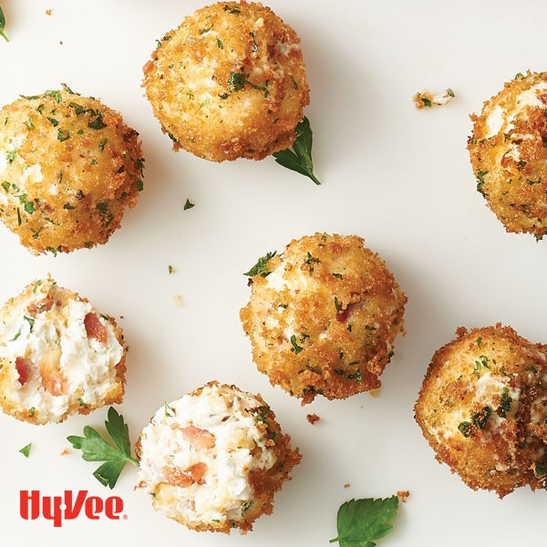 Breaded creamy cheddar balls packed with bacon and topped with Italian parsley