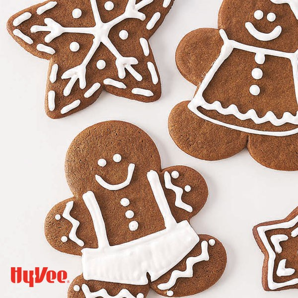 Gingerbread men decorated with white royal icing frosting