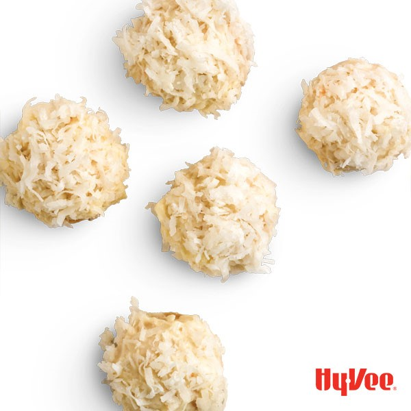 Coconut-flavored cookies dipped in white chocolate and sprinkled with shredded coconut