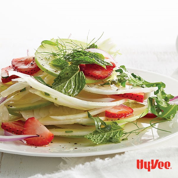 Plate of apple, fennel and strawberry layered salad