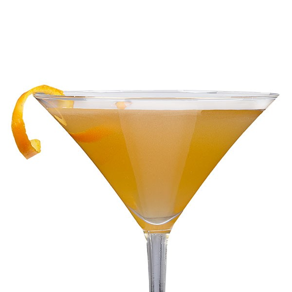 Yellow drink in a martini glass with a orange peel