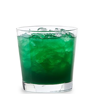 Green drink filled with ice cubes in a clear juice glass