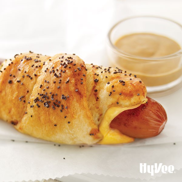 Cheesy piggie in a blanket served with a side of come-back sauce