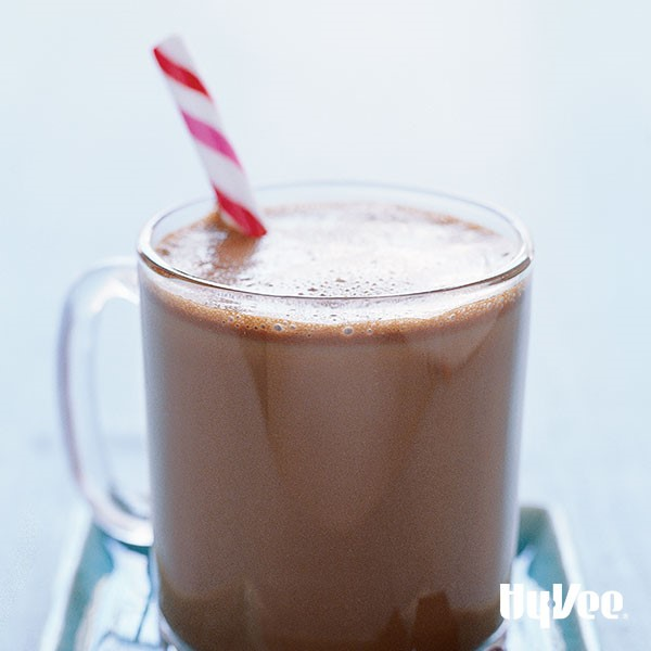 Glass of mocha coffee, garnished with a peppermint stick