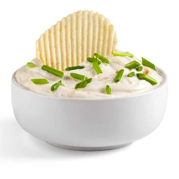 White bowl filled with dip and topped with chopped chives and crinkled potato chip
