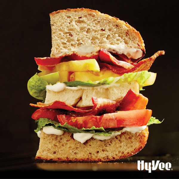 Mayo, tomato wedges, lettuce, and bacon in between slices of thick-cut bread