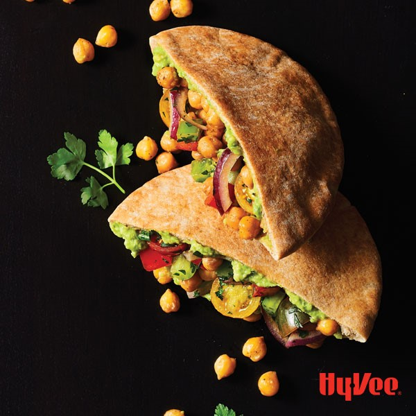 Pitas stuffed with chick peas, tomatoes, and avocados