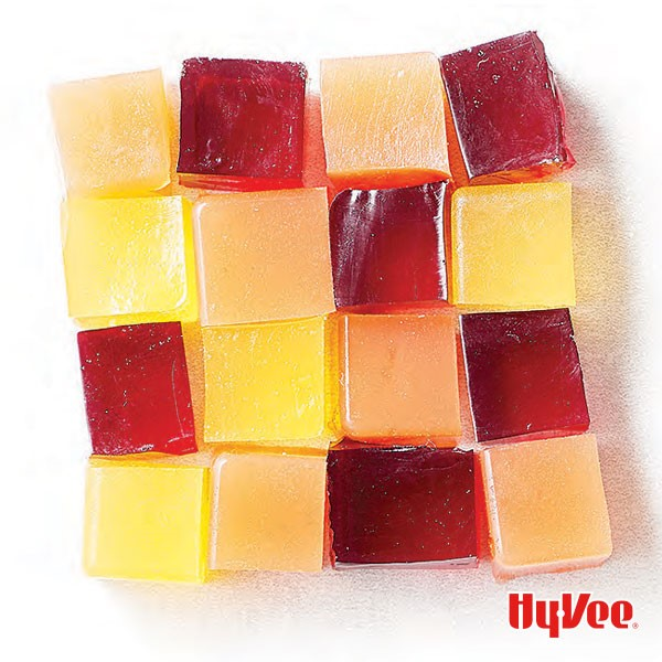 Multicolored homemade gelatin cubes forming a large square