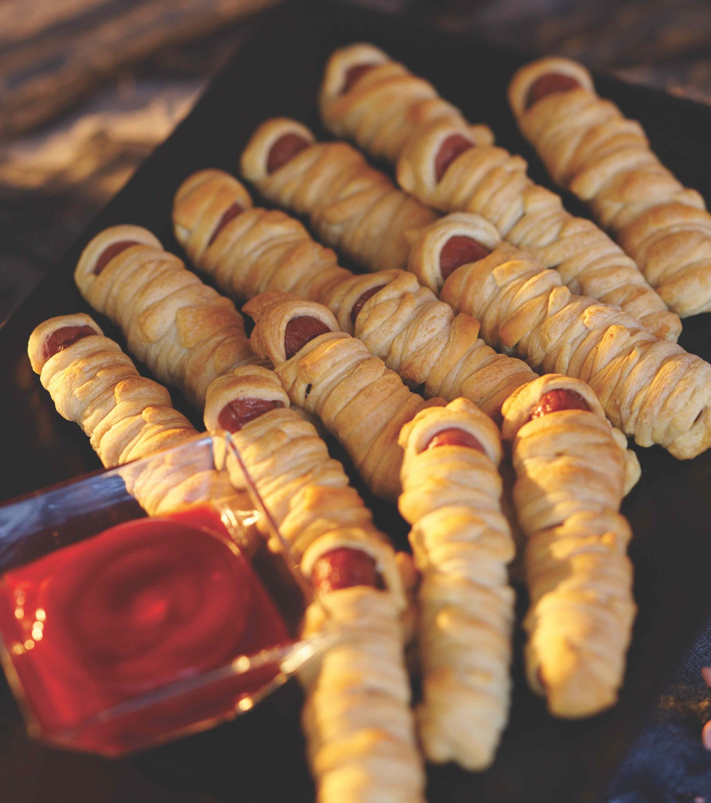 Hot Dogs Wrapped in Thin Pieces of Dough and Baked to Golden Brown
