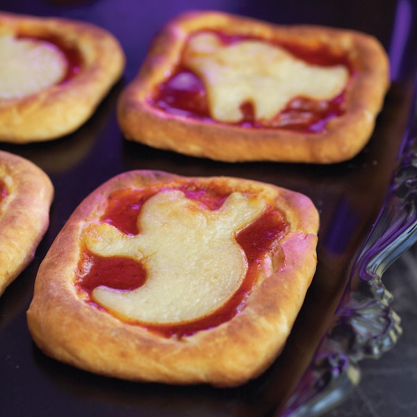 Small Square Pizzas with a Cheese Ghost Placed on top