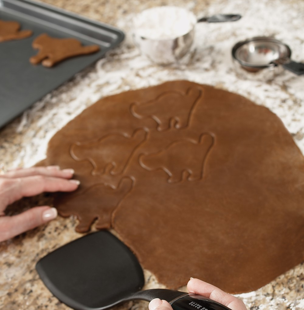 Cutting out Black Cat Cookies from Dark Chocolate Cookie Dough