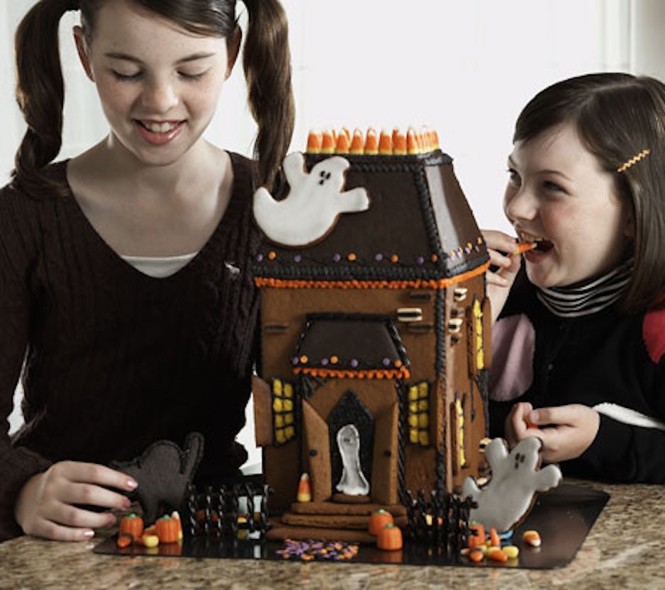 Complete Halloween Mansion with Two Children Eating Candy