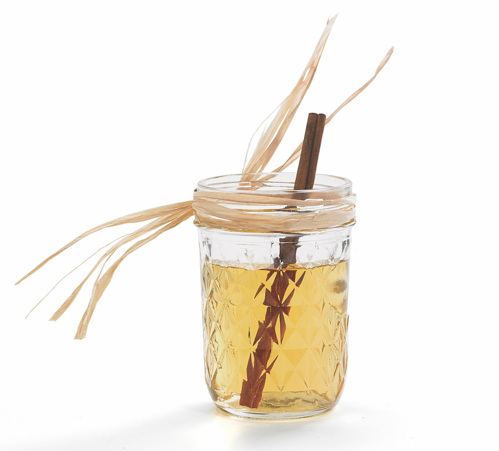Glass Mug of Cider with a Cinnamon Stick