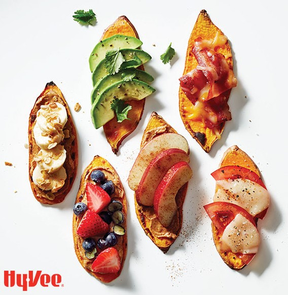 Sweet Potatoes Topped with Various Fruits, Vegetables, Meats and Cheeses